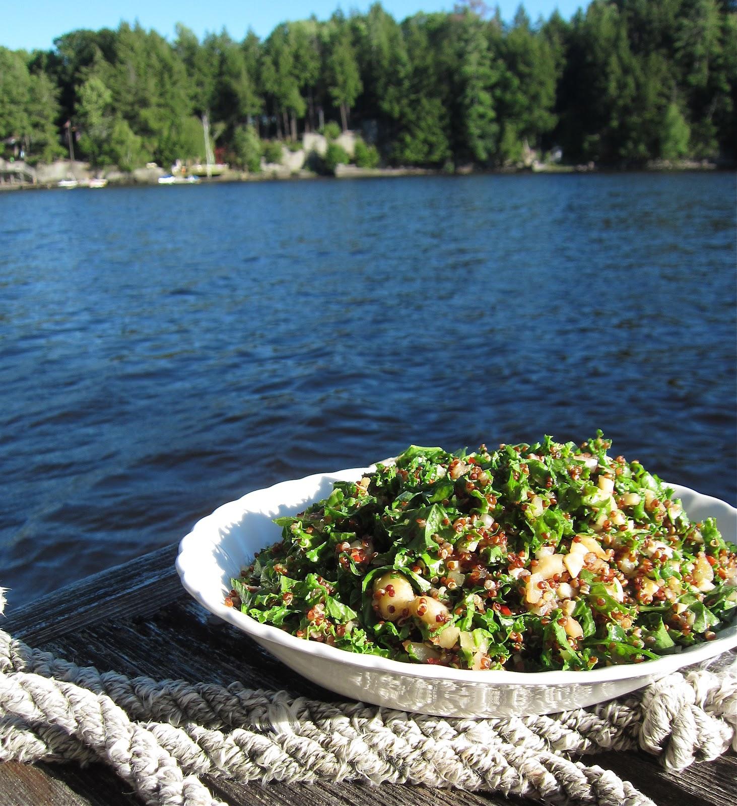Kale salad in a bowl set on a dock in Muskoka.