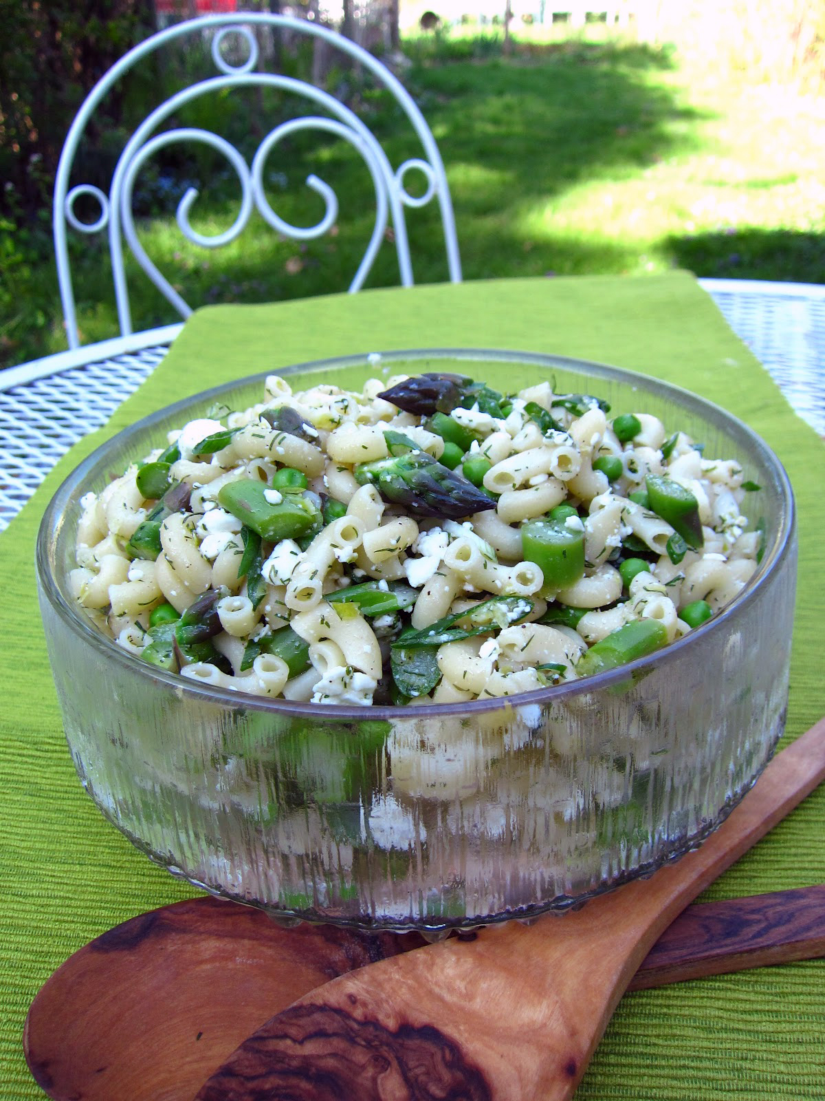 Bowl of asparagus pasta salad with lemon and dill